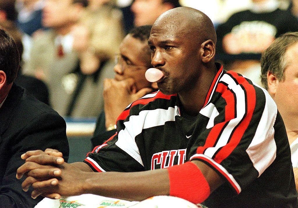 Michael Jordan chews bubble gum on the Bulls' bench.
