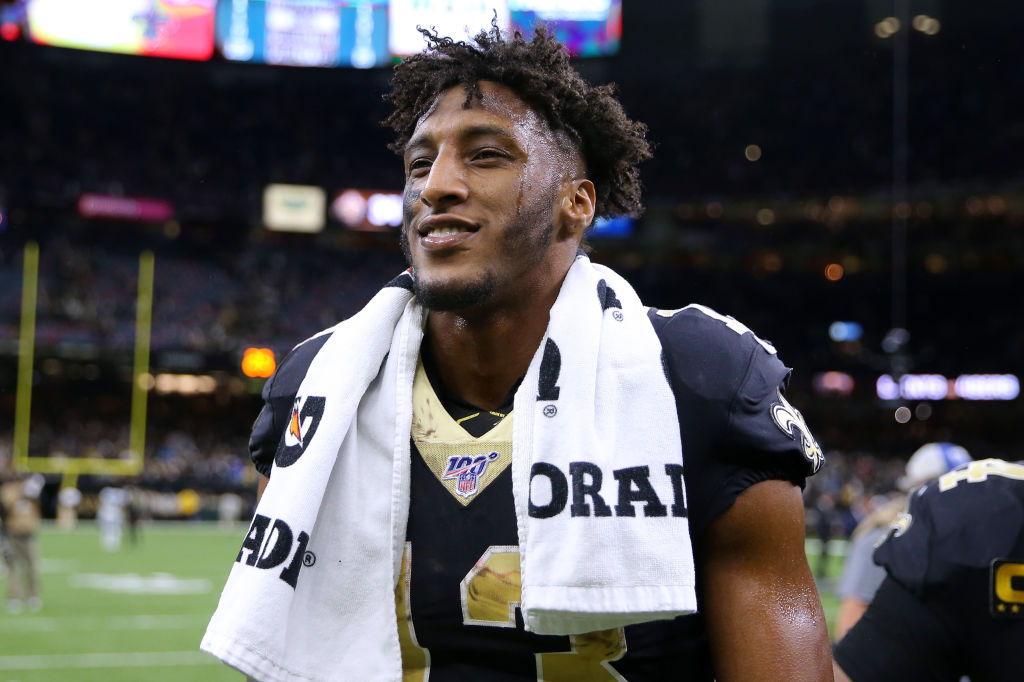 Saints receiver Michael Thomas walks off the field.