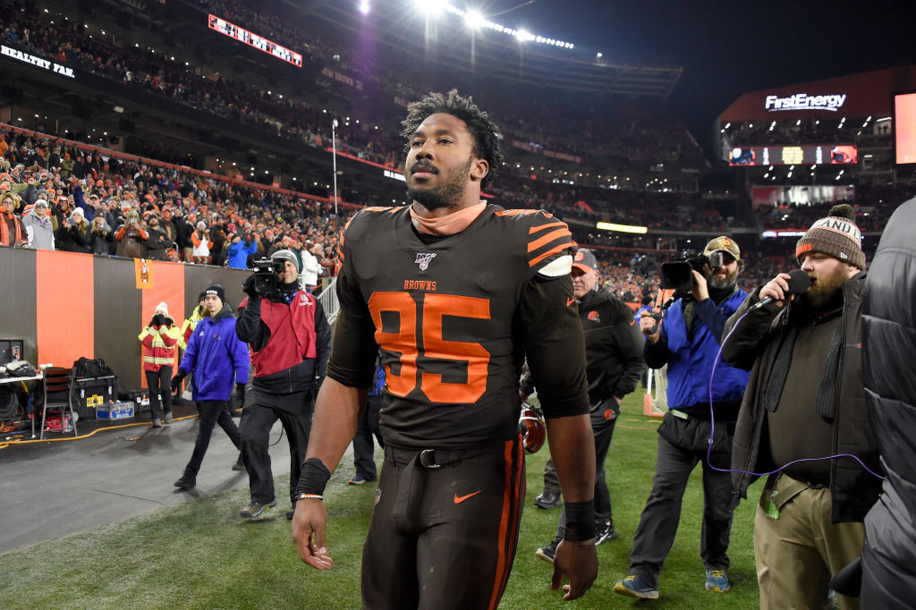 Myles Garrett walking off the field after being ejected.