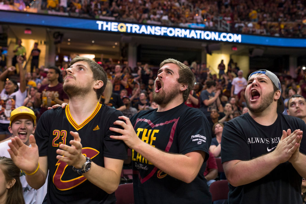 NBA fans react to the end of the a game.