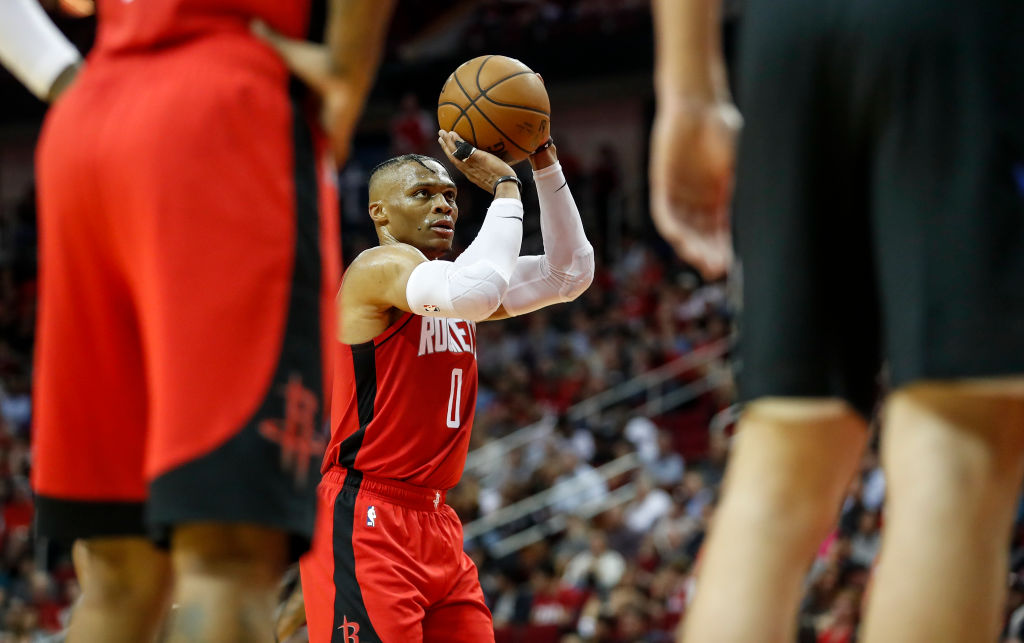 NBA player Russell Westbrook shoots a foul shot during a game.