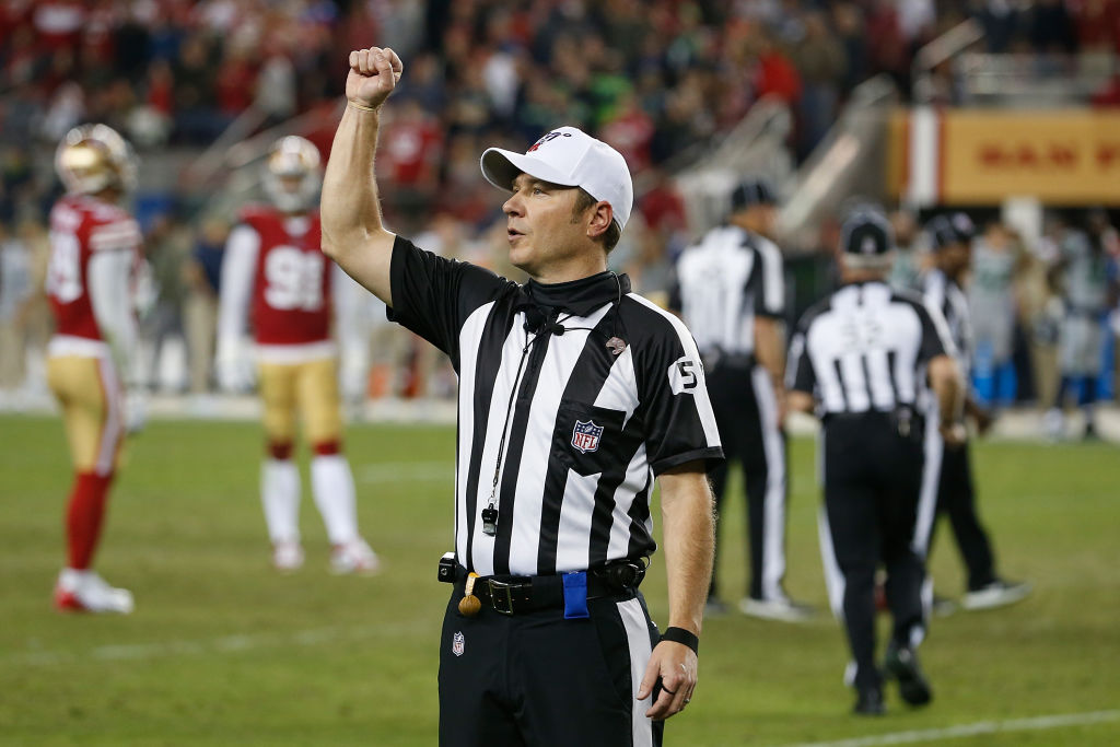 An NFL referee makes a call during a game.
