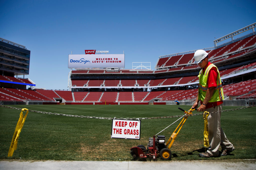Kyle Calhoon, a grounds manager for Levi's Stadium, edges the grass