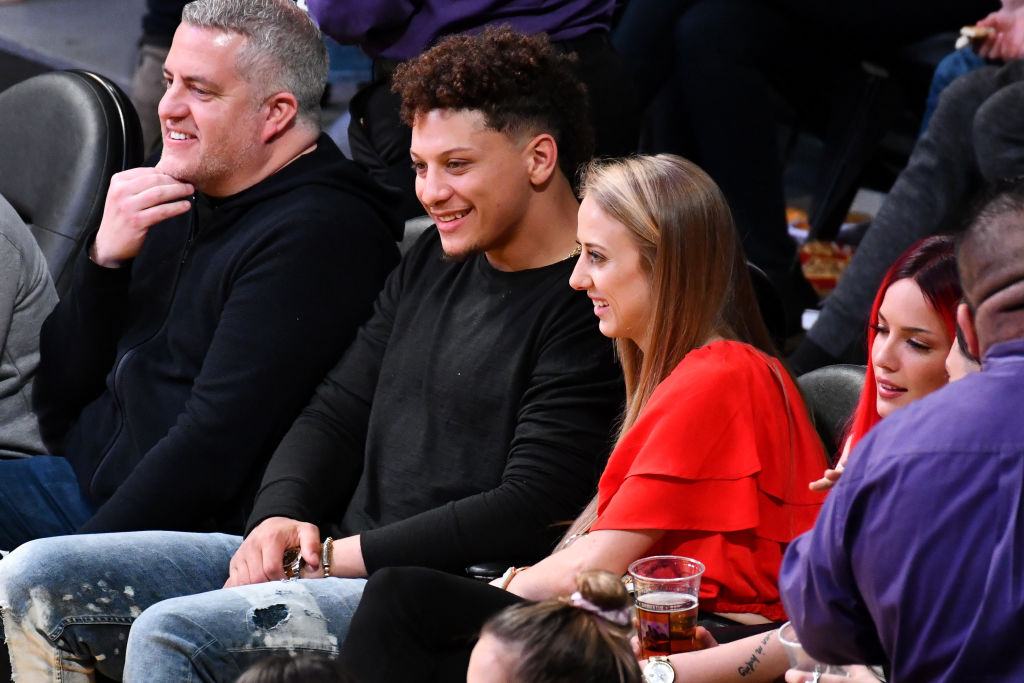 Patrick Mahomes and Brittany Matthews attend a basketball game
