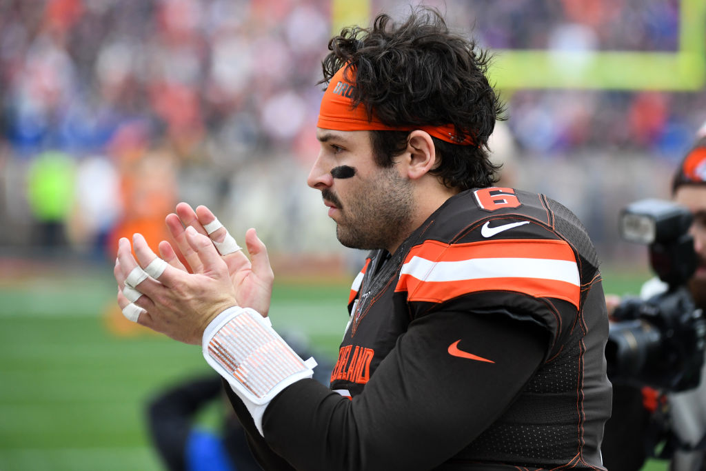Quarterback Baker Mayfield of the Cleveland Browns applauds after the National Anthem prior to a game