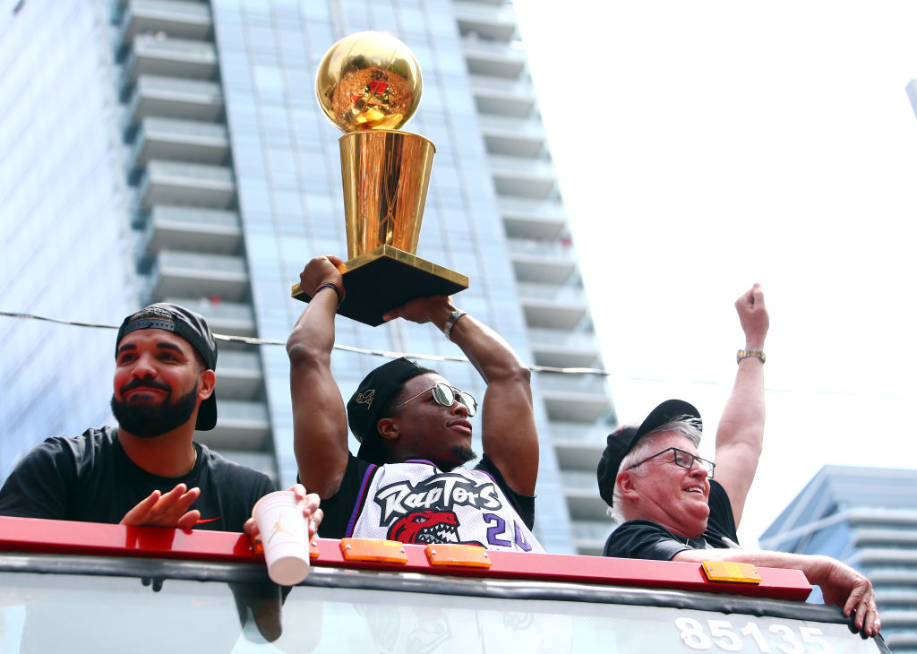 Kyle Lowry (center) and the Raptors enjoyed the prestige of winning the NBA title in 2019, and they got huge championship rings, but Drake (left) added another bit piece of loot to the haul.