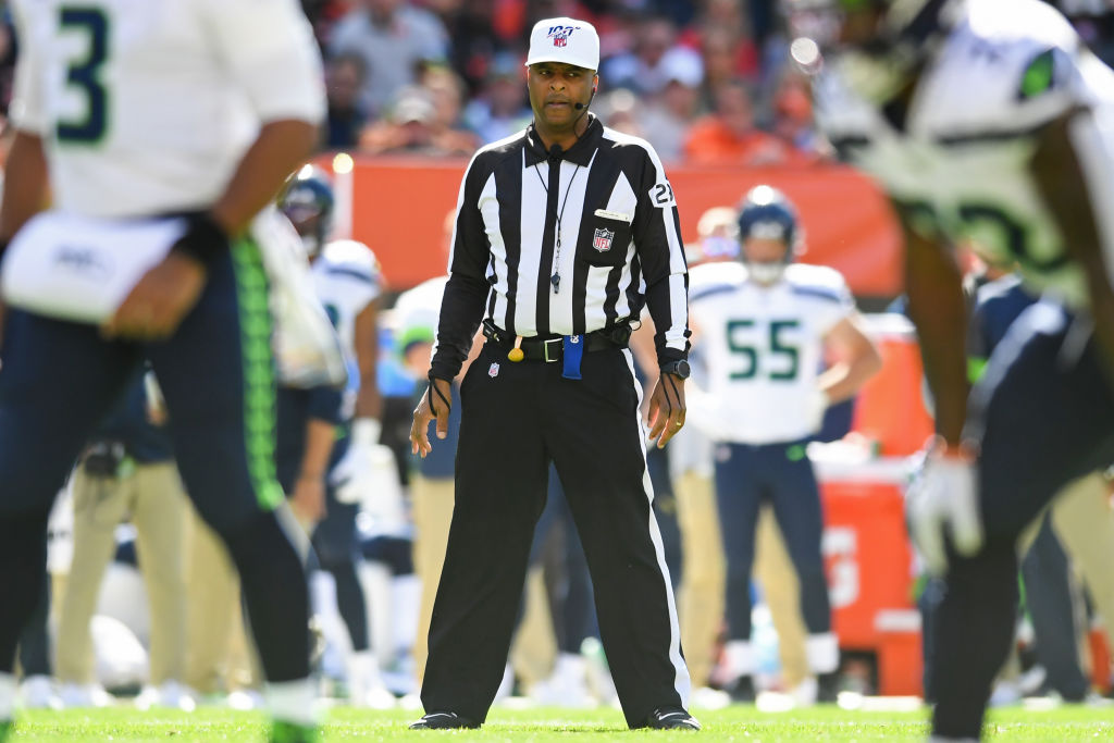 Referee Adrian Hill waits for the snap