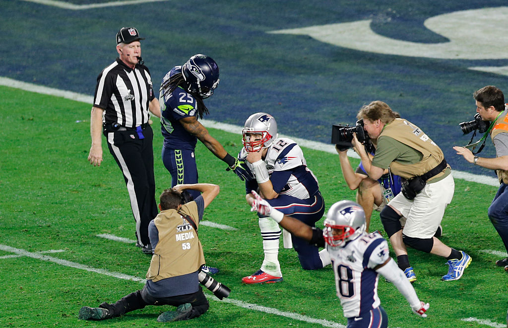 Richard Sherman of the Seattle Seahawks extends a hand of congratulation to Tom Brady of the New England Patriots