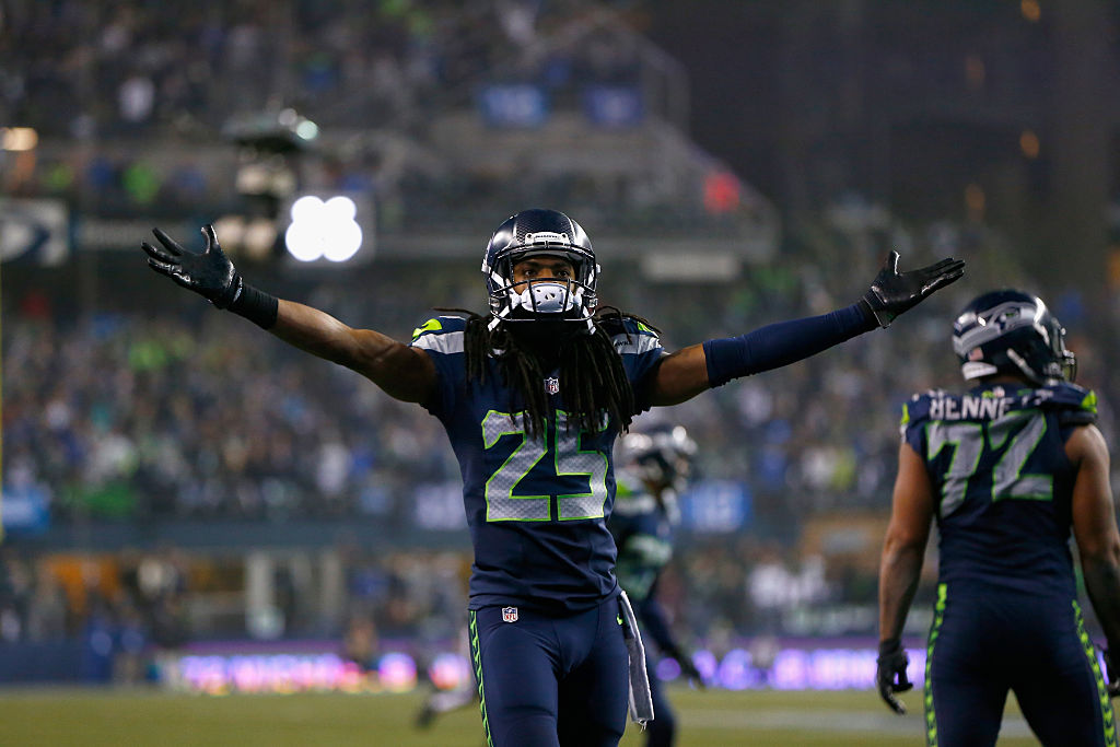 NFL cornerback Richard Sherman celebrates after making a play.