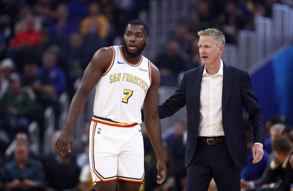 NBA rookie, Eric Paschall, talks with coach Steve Kerr