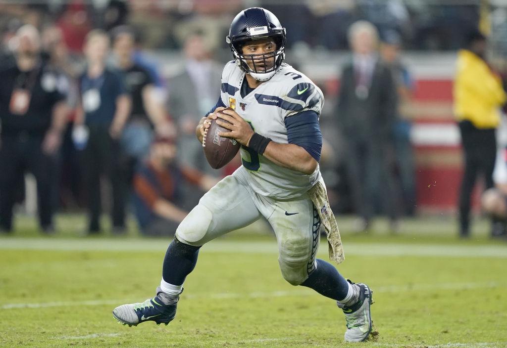 NFL quarterbacks, like Russell Wilson, command massive salaries.