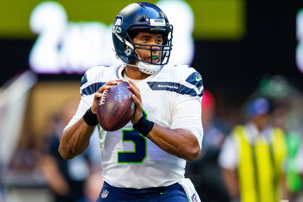 Seahawks' quarterback, Russell Wilson, drops back for a pass.