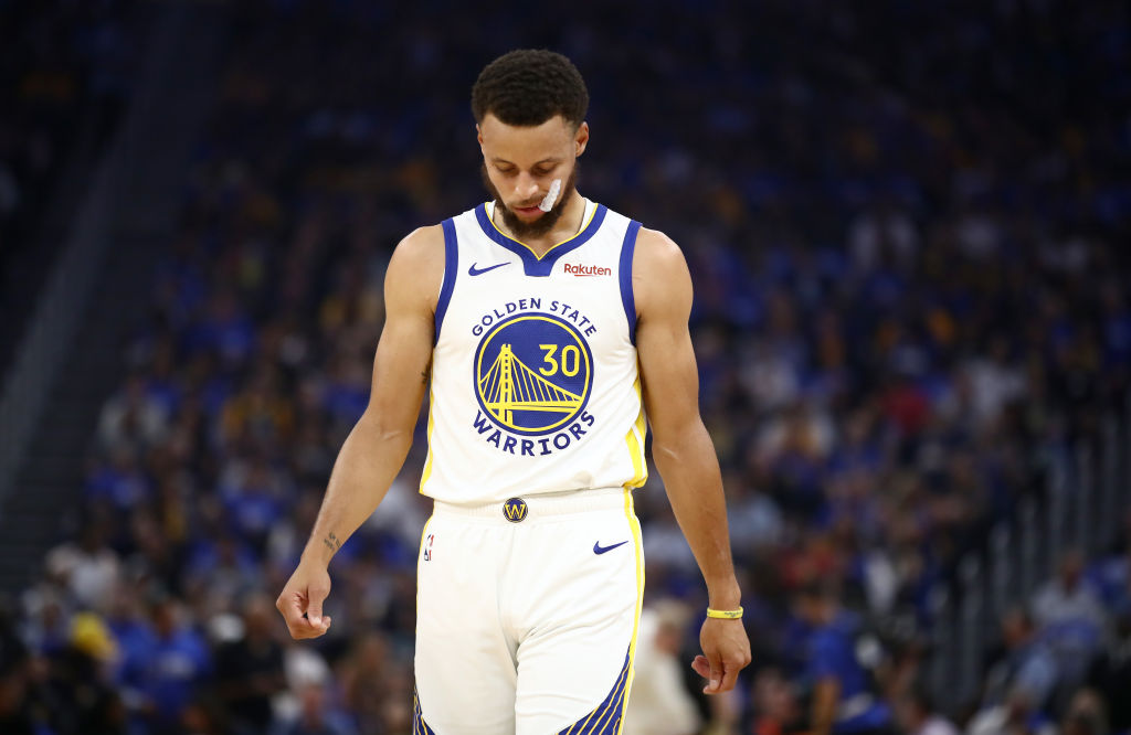 Golden State Warriors' guard Steph Curry hangs his head.