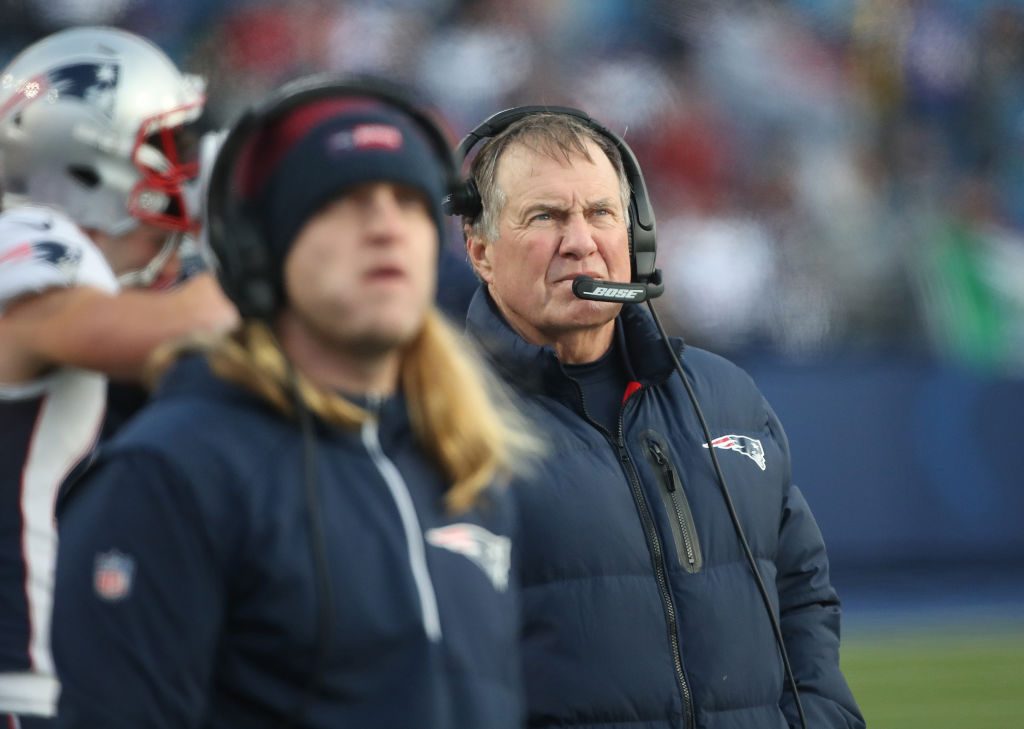 Patriots' coaches Steve and Bill Belichick on the sideline during a game.
