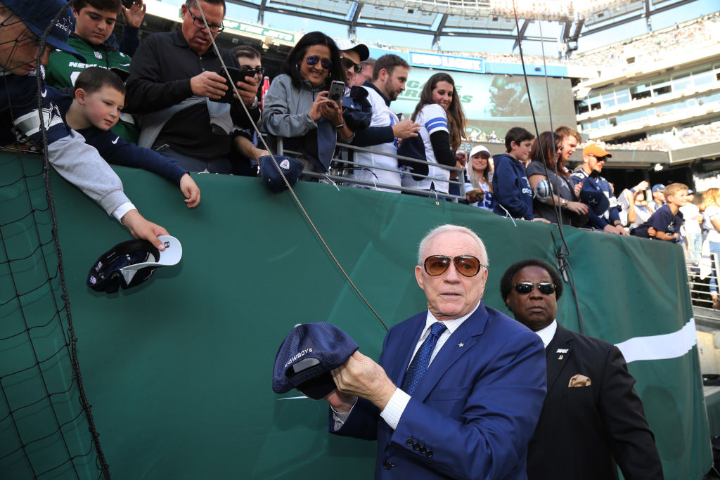 Team Owner Jerry Jones of the Dallas Cowboys signs autographs