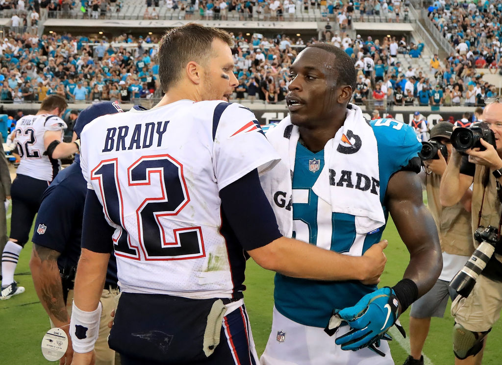 Telvin Smith of the Jacksonville Jaguars is congratulated by Tom Brady of the New England Patriots following a 2018 game