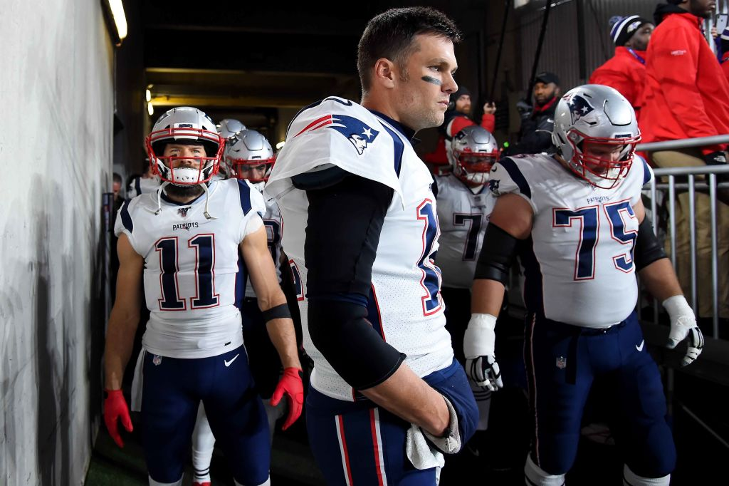 Tom Brady, Julian Edelman, and Ted Karras of the New England Patriots look on prior to playing against the Baltimore Raven