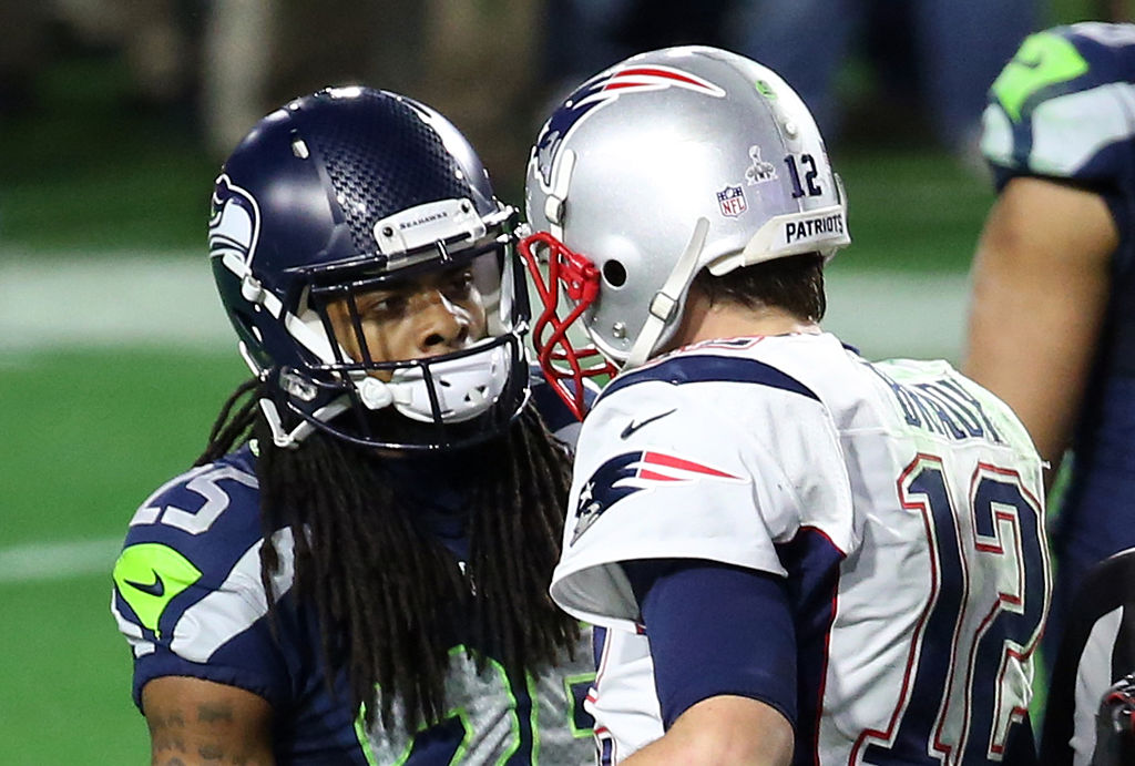 Tom Brady and Richard Sherman talking during a game.