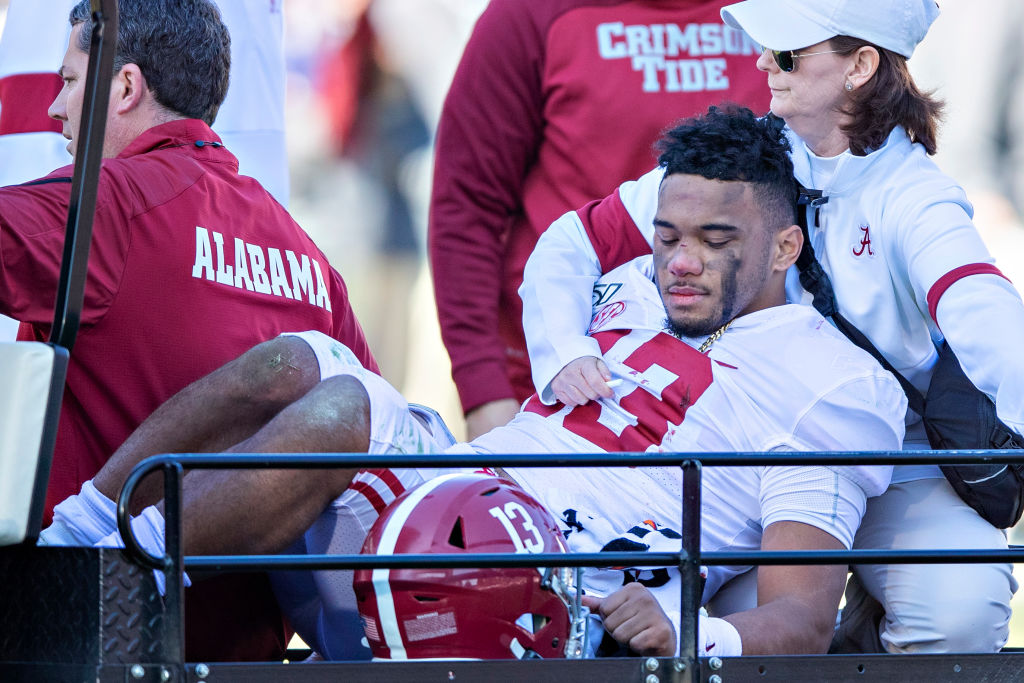 Tua Tagovailoa being carted off of the field in what will likely be his final appearance as a member of the Crimson Tide