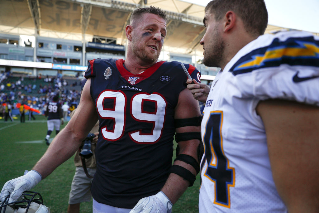 Two of the Watt Brothers, J.J. an Derek talk after a game.