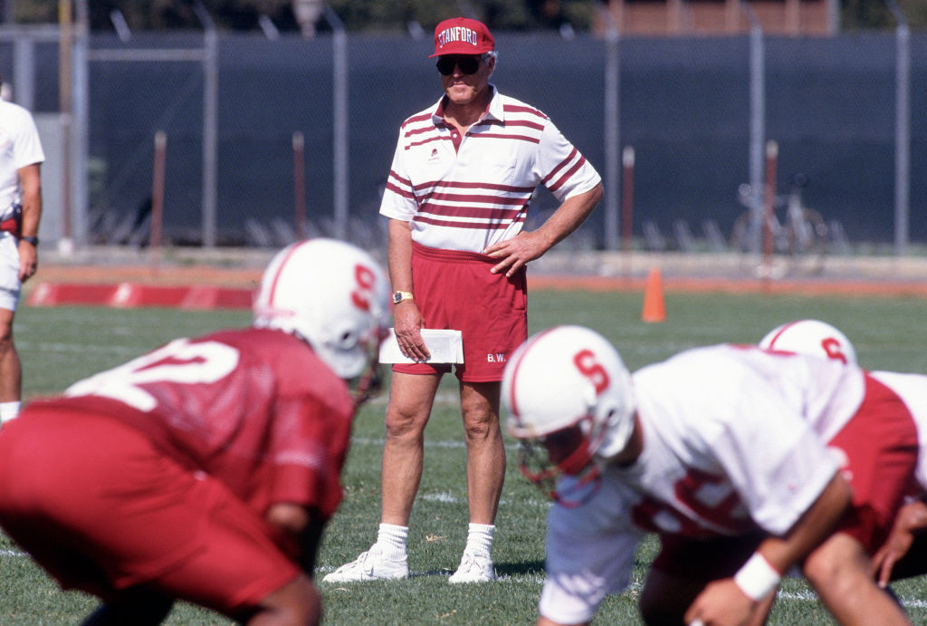 Head coach Bill Walsh of the Stanford Cardinal looks on during practice in 1992
