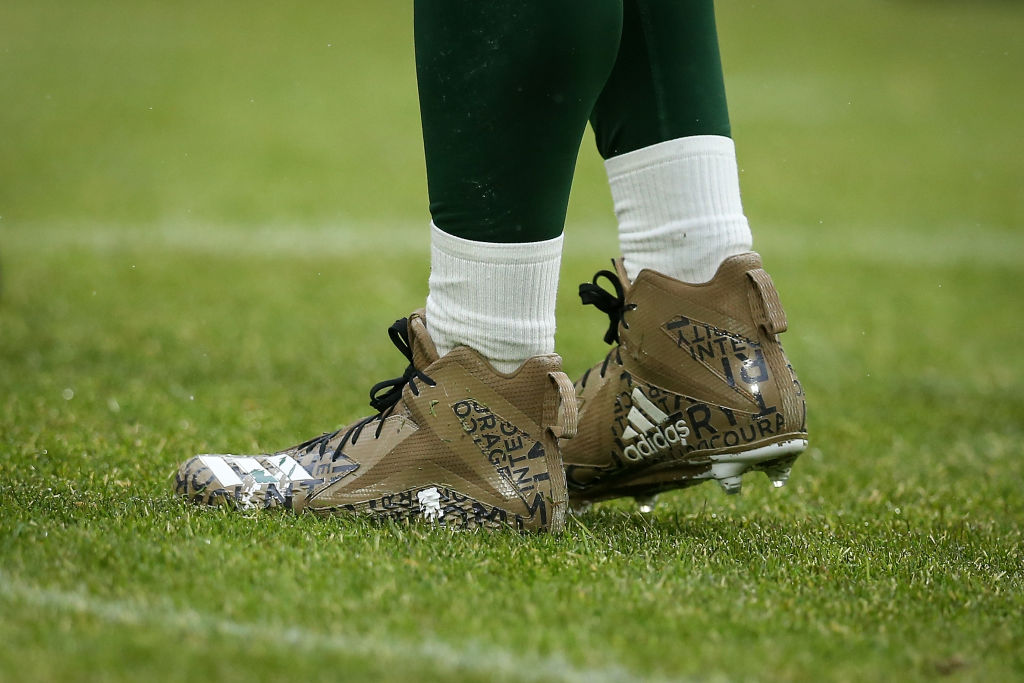 A detail view of special edition Adidas cleats worn by Aaron Rodgers of the Green Bay Packers