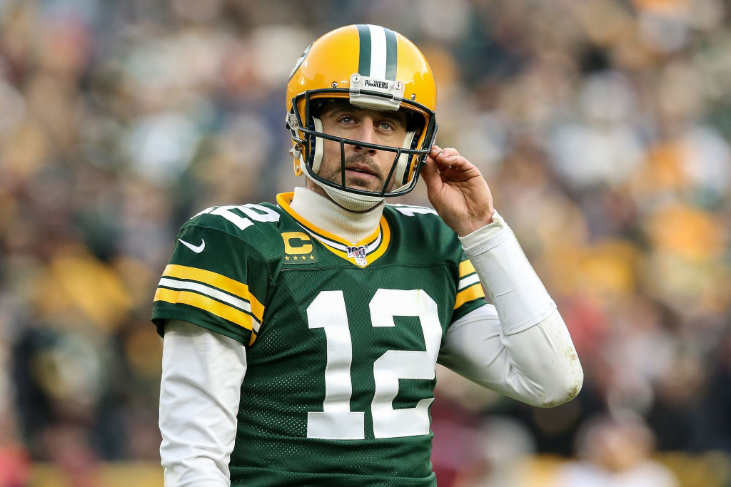 Aaron Rodgers of the Green Bay Packers walks across the field