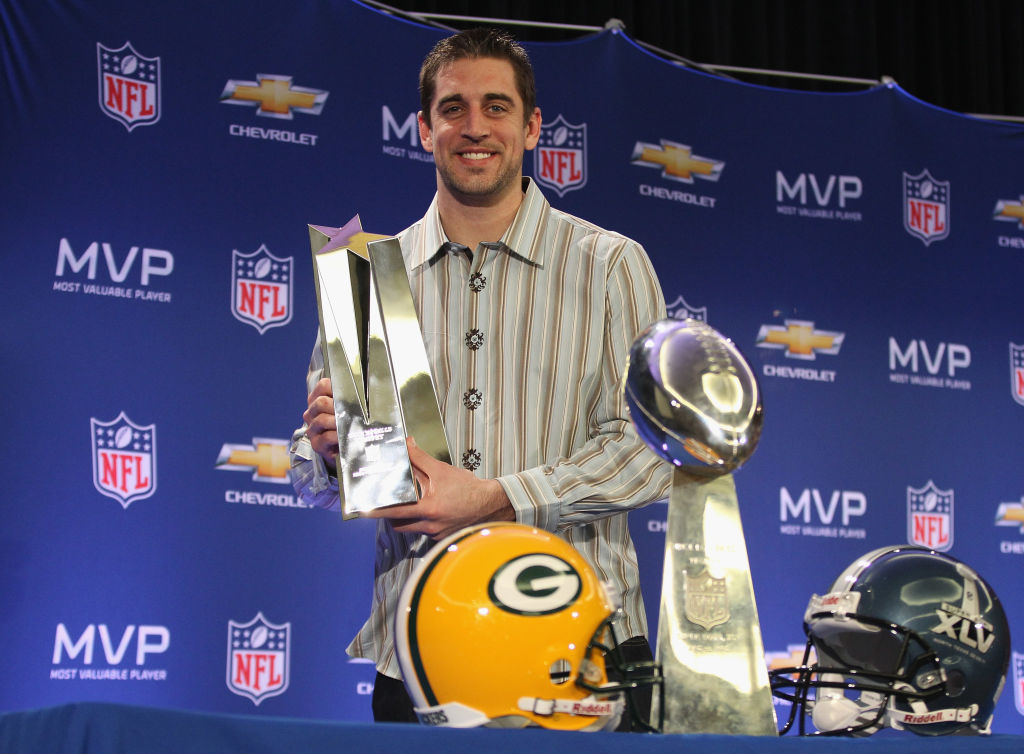 Aaron Rodgers accepts an NFL Super Bowl MVP award.