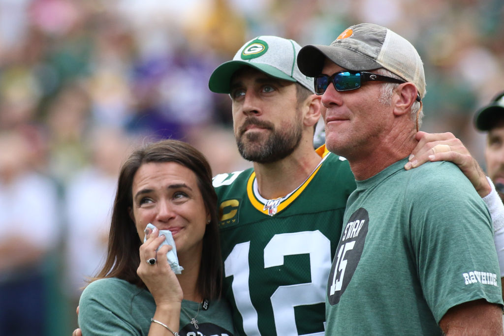 Aaron Rodgers and Brett Favre at midfield for a tribute