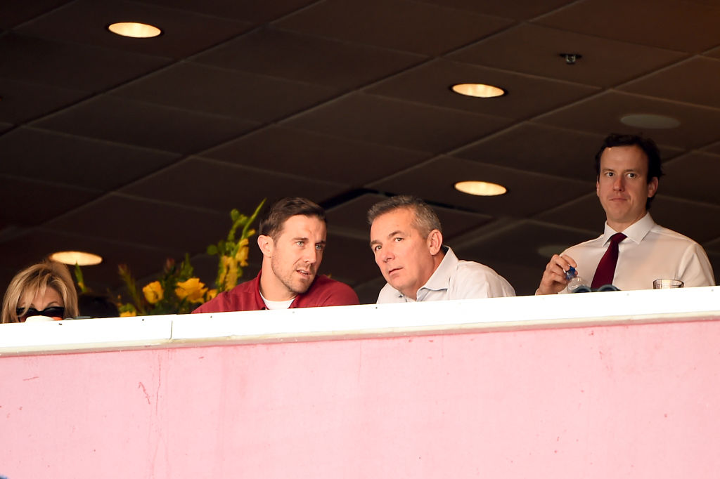 Alex Smith of the Washington Redskins and Urban Meyer speak