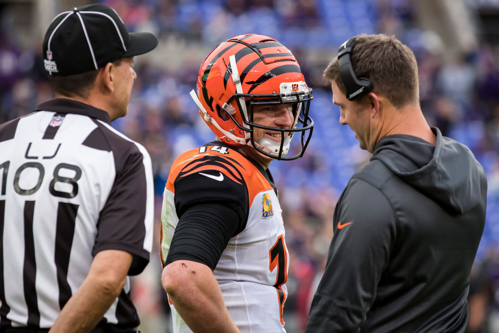 Andy Dalton of the Cincinnati Bengals speaks with head coach Zac Taylor