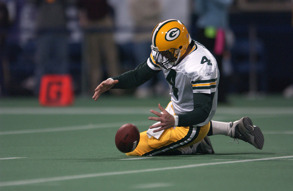 Brett Favre of the Green Bay Packers fumbles the ball