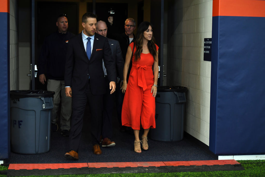 Case Keenum and his wife, Kim, walking out of the tunnel