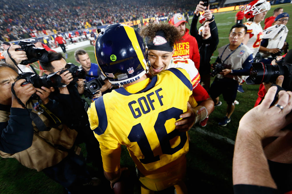 Jared Goff of the Los Angeles Rams hugs Patrick Mahomes of the Kansas City Chiefs after a high scoring NFL game