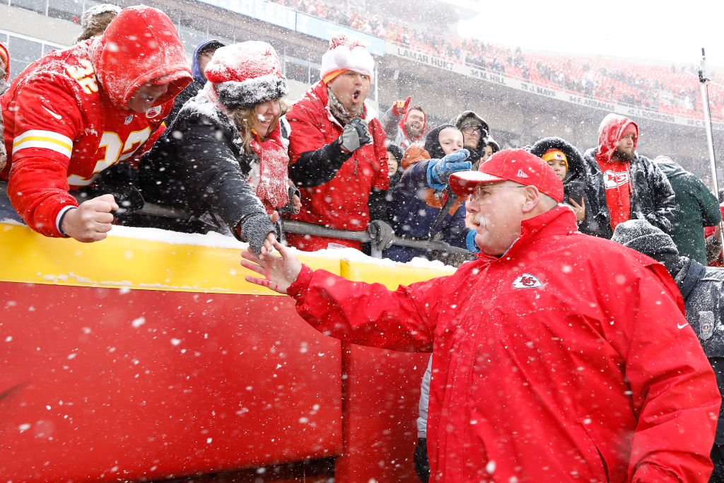 Head coach Andy Reid of the Kansas City Chiefs greets fans following their win over the Denver Broncos