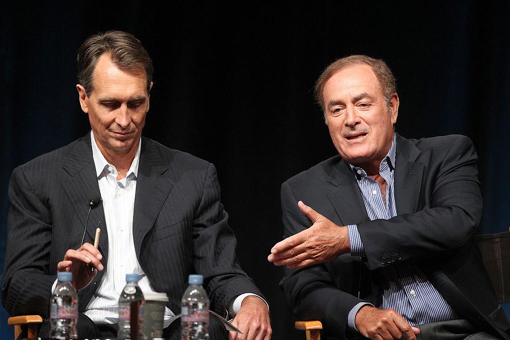 Cris Collinsworth and Al Michaels at a media event