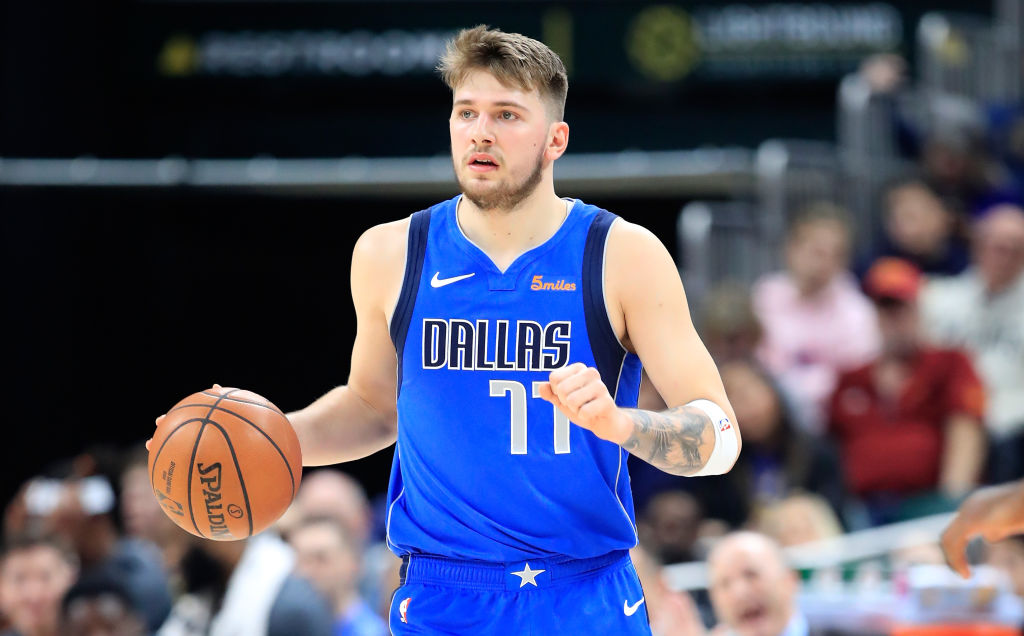 Luka Doncic dribbles up the court during a game.