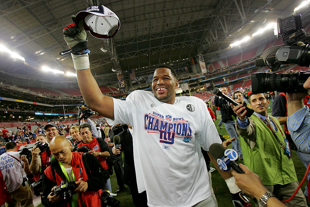 Defensive end Michael Strahan of the New York Giants celebrates after defeating the New England Patriots during Super Bowl XLII