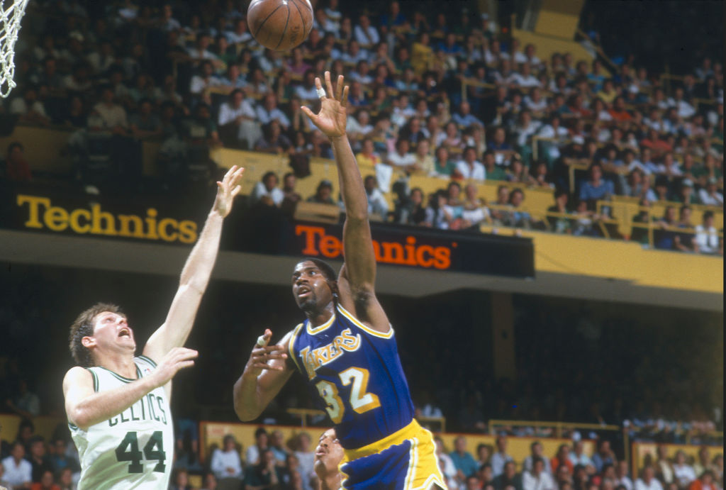 Earvin Magic Johnson of the Los Angeles Lakers shoots over Danny Ainge of the Boston Celtics