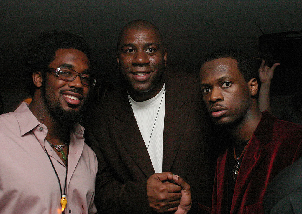 Dhani Jones of the NY Giants, Earvin Magic Johnson, and Pras Michel pose for a photo in 2003