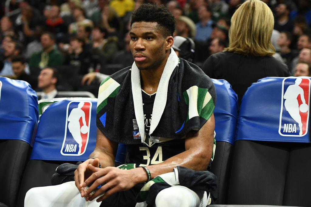 Giannis Antetokounmpo of the Milwaukee Bucks sits on the bench