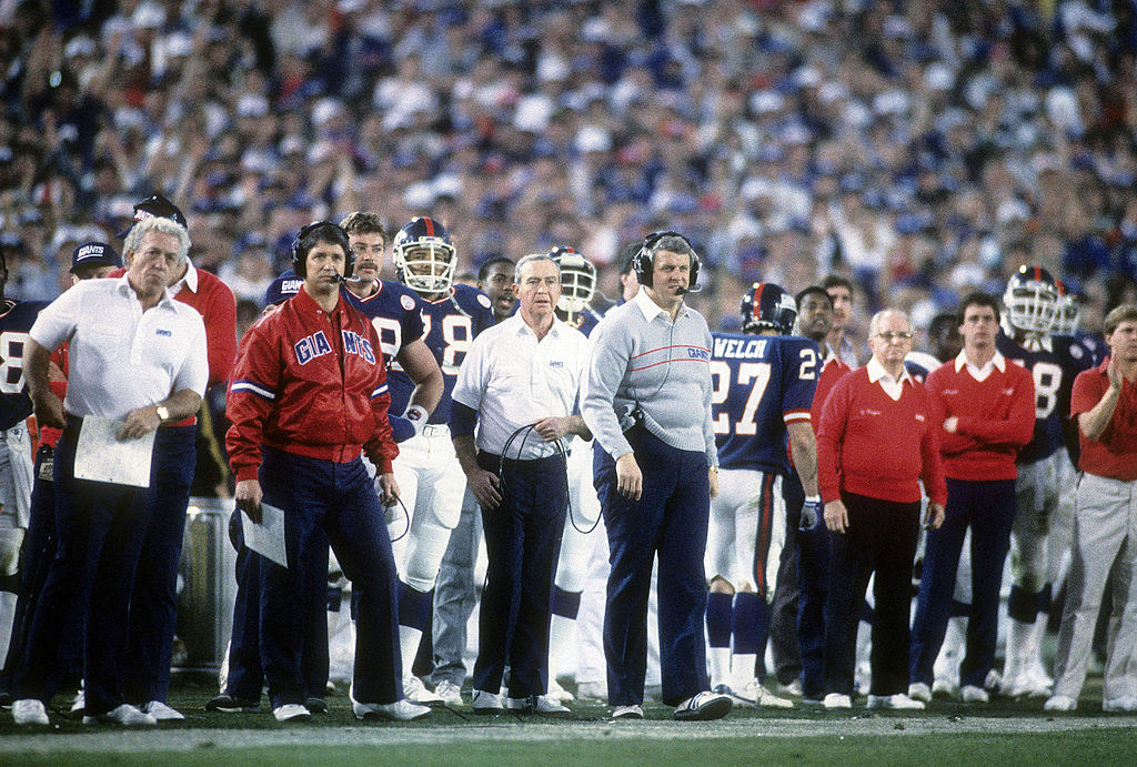 Head Coach Bill Parcells of the New York Giants with the head set on