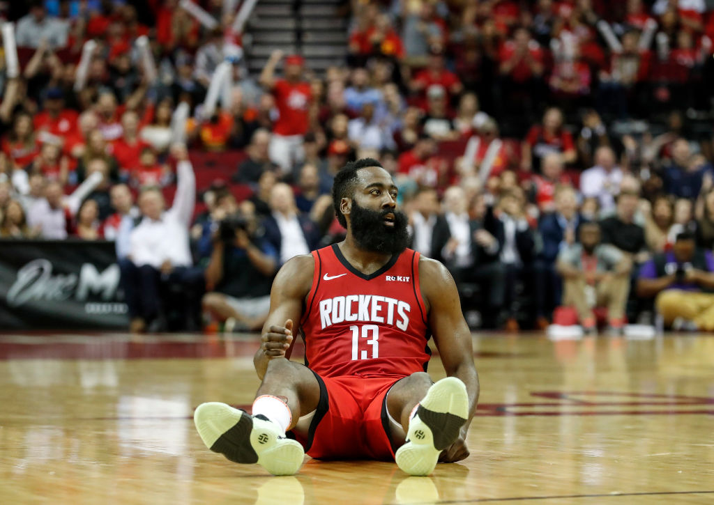 James Harden of the Houston Rockets reacts after a three point shot