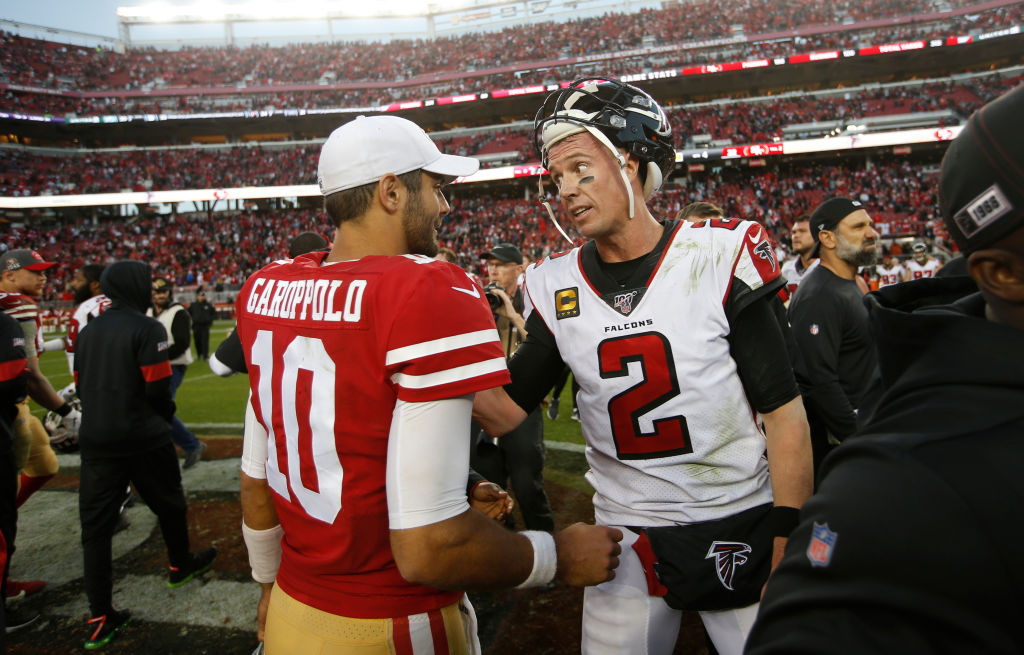 Jimmy Garoppolo of the San Francisco 49ers and Matt Ryan of the Atlanta Falcons talk on the field