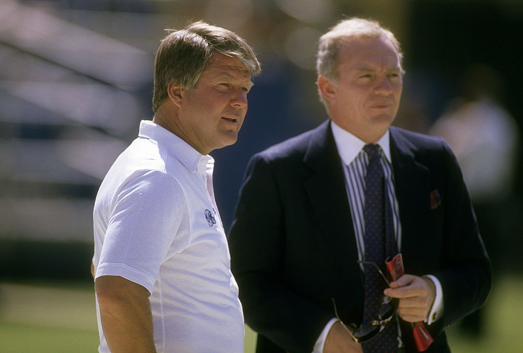 Former Cowboys coach, Jimmy Johnson talking with Jerry Jones.