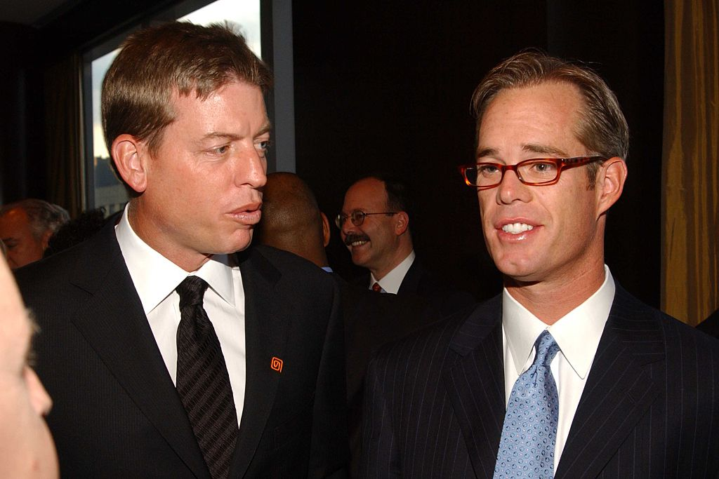 Joe Buck standing next to his broadcast partner Troy Aikman.