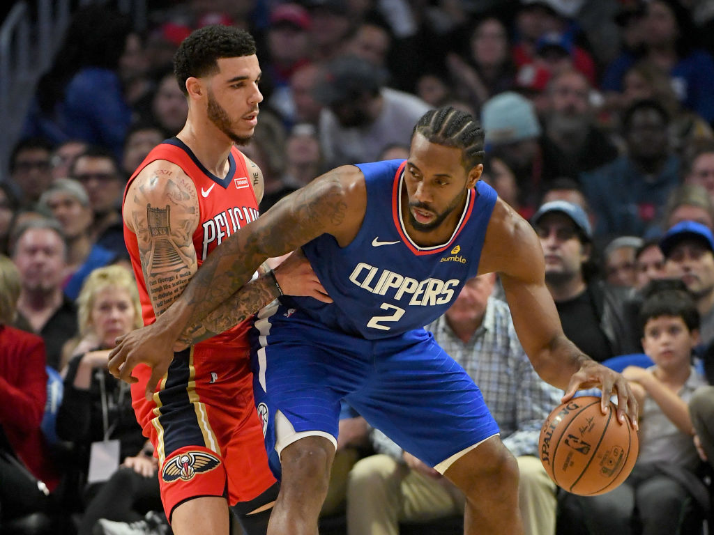 Kawhi Leonard of the Los Angeles Clippers posts up against Lonzo Ball of the New Orleans Pelicans