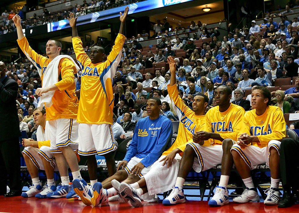 Kevin Love, Darren Collison, Russell Westbrook, Josh Shipp, and James Keefe of the UCLA Bruins celebrate on the bench in 2008