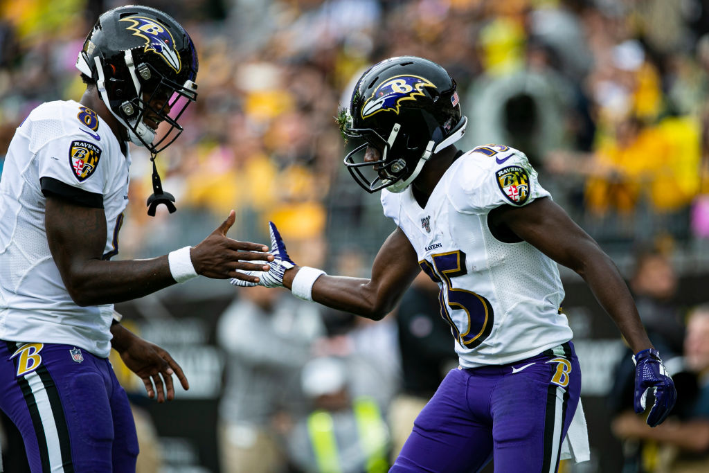 Lamar Jackson and Marquise Brown celebrating after a touchdown