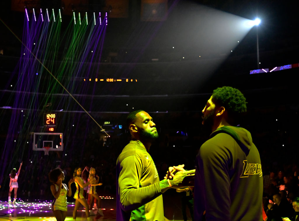 LeBron James and Anthony Davis of the Los Angeles Lakers talk before a game